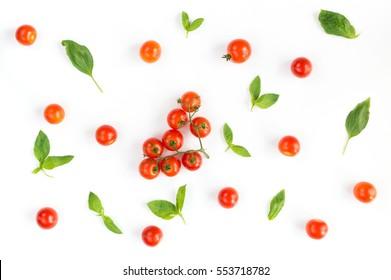 Italian food pattern with red tomatoes and basil leafs isolated on white background