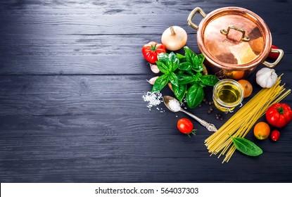 Italian food preparation pasta on wooden board in style copyspace.