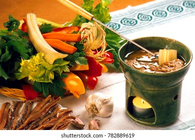 Italian food recipes, traditional Piedmont recipe, Bagna cauda a hot spicy sauce of garlic and anchovies to be consumed with raw vegetables.