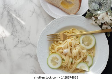 Italian food, scallop and lemon fettuccine