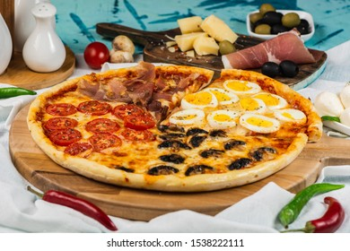 Italian Four Seasons Pizza (Pizza Quattro Stagioni). Proschutto, mushroom, cherry tomato, egg.