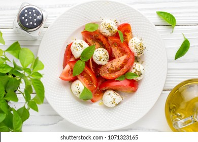 Italian fresh tomato Caprese salad, mozzarella and Basil, delicious light summer snack