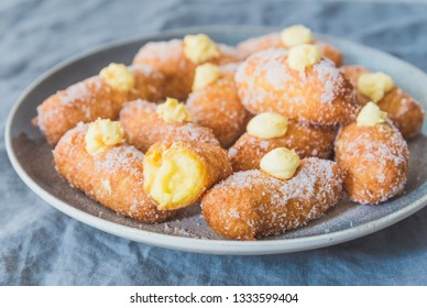 Italian fritters sweet pastry.Traditional italian desserts made with rice and filled with pastry cream - frittelli.