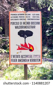 Italian - German warning sign to not make or use fire in the forests.