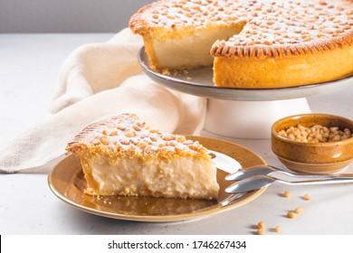 Italian Grandma's cake - Torta della nonna.  Pine nut custard tart from Tuscany, Italy. Copy space.