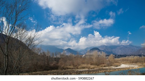 Italian hills of Valdobbiadene and beautyful mountains in the background. March landscape. Fall Winter.