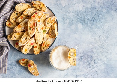 Italian homemade biscotti or cantuccini with almond and dry fruits and a cup of coffee. Traditional double baked cookies.