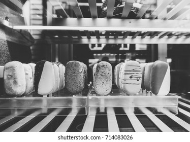 Italian ice cream shop in diverse multicolored flavors made from organic ingredients in showcase window of a traditional vintage icecream shop black and white