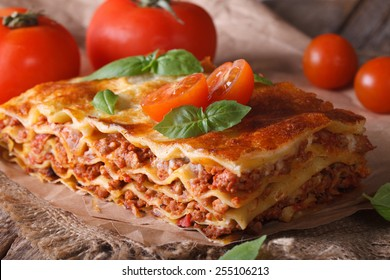 Italian lasagna close-up on the table. horizontal rustic style