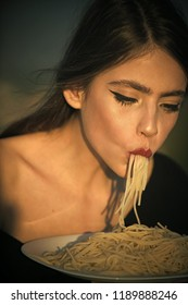 Italian macaroni or spaghetti for dinner, cook. Woman eating pasta as taster or restaurant critic. Chef woman with red lips eat pasta. Diet and healthy organic food, italy. Hunger, appetite, recipe