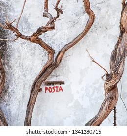 Italian mailbox, house