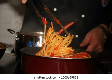 Italian master chef cooking bucatini all'amatriciana