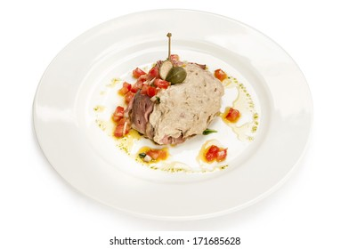 Italian meal. vitello tonnato, veal with tuna and capers isolated on white.