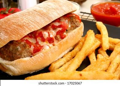 Italian meatball sandwich, spicy fries and honey mustard sauce.