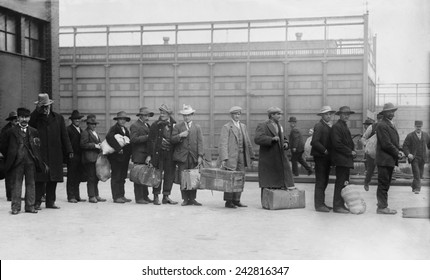 Italian men await admission processing at Ellis island, were among the 2,000 Italian immigrants the arrived on the Prinzess Irene which grounded on Fire Island sandbars. Ca. 1910.