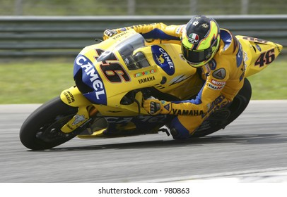 Italian MotoGP roder Valentino Rossi takes a corner during a 2006 pre-season test at Sepang International Circuit, Malaysia.