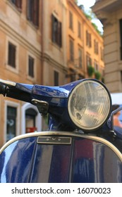 Italian motorbike/scooter in Rome,Italy with buildings to background.