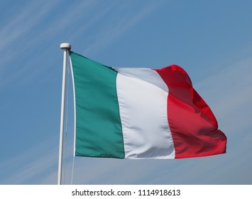 the Italian national flag of Italy, Europe over blue sky