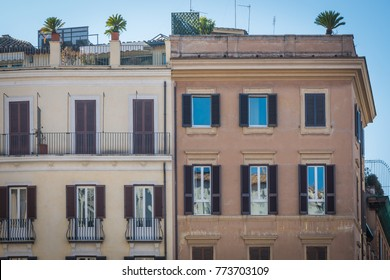 Italian old tenements near the Spanish Steps in Rome, Italy, sunny day, visible roof with palm trees