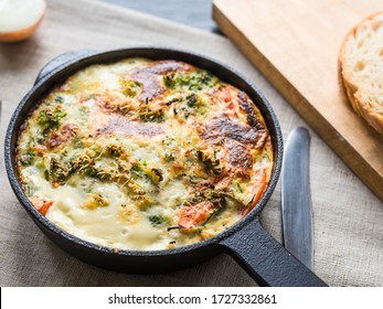 Italian omelet, frittata with broccoli in a cast-iron pan, top view, close-up - breakfast at home