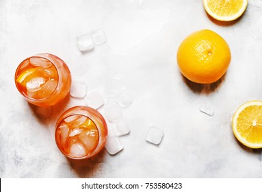 Italian Orange Cocktail With Bitter Aperitif, Ice Cubes, Sparkling Wine And Orange Slice, Top View