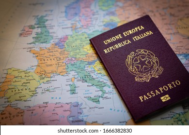 Italian passport with European political map. Close up view