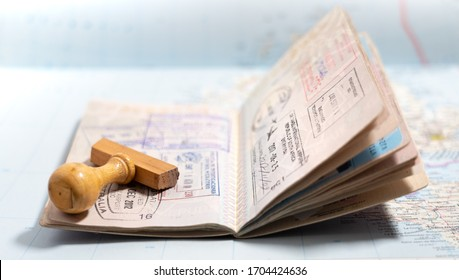 Italian passport pages with a lot of visa stamps.
