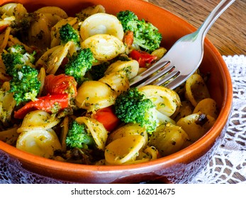 italian pasta called orecchiette with  typical italian recipe and vegetables