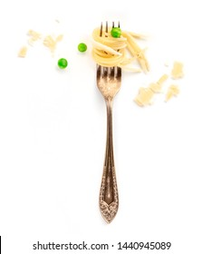 Italian pasta design element. A fork with spaghetti, green peas, and parmesan cheese, shot from above on a white background with copy space