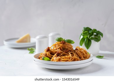 Italian pasta with dried tomatoes, selective focus