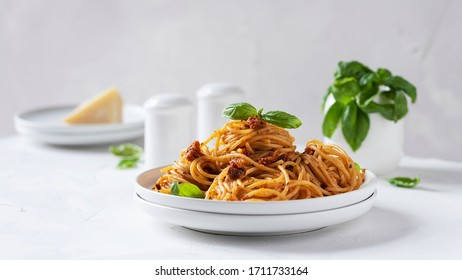 Italian pasta with dried tomatoes, selective focus and slider format