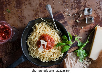 Italian pasta food (spaghetti, Parmesan, wine, rose and fresh herbs)