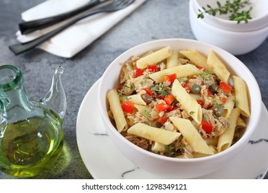 Italian pasta penne with with tuna, bell pepper, olive oil and cappers