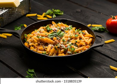 Italian pasta skillet dish. This quick & delicious pasta meal is made with penne pasta, fresh tomato sauce and sausage. This italian inspired comfort food is cooked and served in a cast iron skillet.