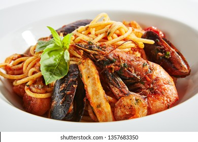 Italian Pasta with Squid, Scallop, Prawns, Salmon, Cod, Blue Mussels, Shrimps, Garlic, Onion, White Wine, Basil, Kalamata Olives, Cherry Tomatoes, Tomato Sauce, Parmesan Cheese Close Up