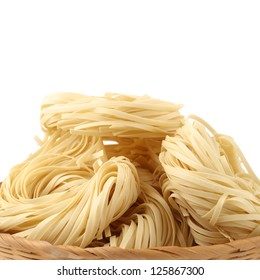 Italian pasta tagliatelle nest on white background