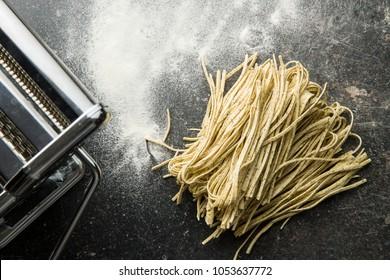 Italian pasta tagliolini with truffles and pasta maker.