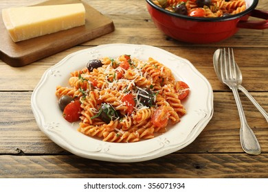 italian pasta with  tomato sauce on rustic table background