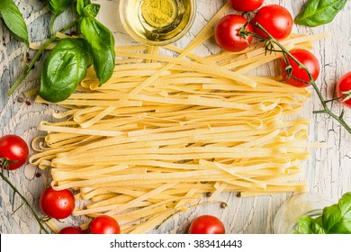 Italian pasta with tomatoes, basil and oil, top view