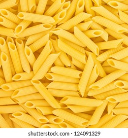 Italian Penne Rigate Macaroni Pasta raw food background or texture close up