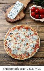 italian pizza with cheese and gorgonzola rustic background