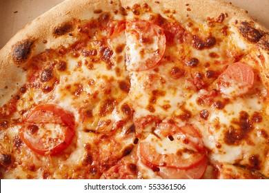 Italian Pizza Margherita (Margarita) with tomato and Mozzarella cheese - background.