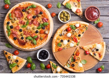 Italian pizza with mozzarella , tomato , olives and mushrooms