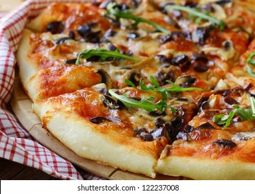 Italian pizza with mushrooms and olives