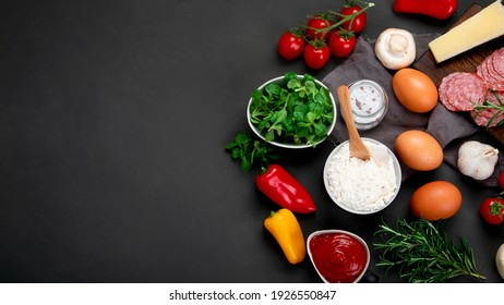 Italian pizza preparation. Variety of traditional cooking ingredients. Homemade delicious recipe concept. Top view, copy space