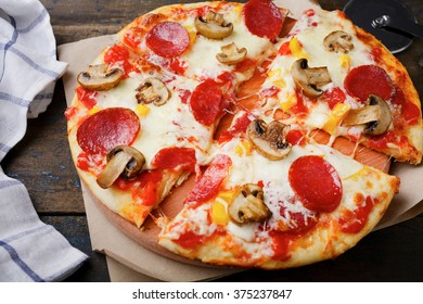 Italian Pizza with sausage and mushrooms. Traditional food