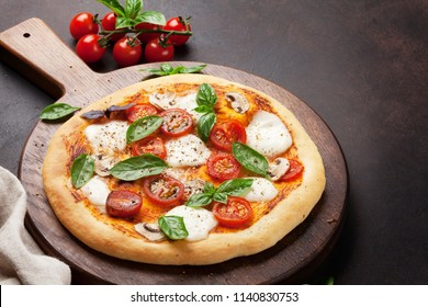Italian pizza with tomatoes, mozzarella and basil. With space for your text