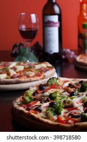 Italian Pizza and wine on wooden table