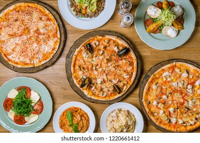 Italian pizzas and salads top view