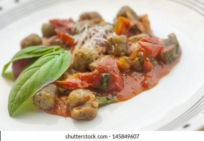 Italian potato gnocchi with tomato sauce and basil